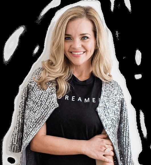 Gaby Abrams Entrepreneur success coach in a silver jacket